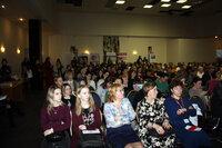 В аудитории Конференции по акне, розацеа и патологии сально-волосяного фолликула